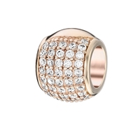 Gold charm with zirconium